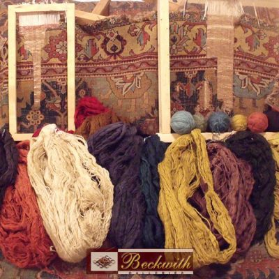 Wool and Yarn bundles in front of a carpet