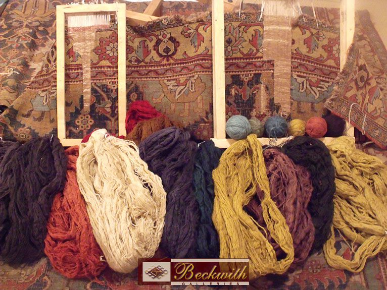 Photo of Wool and Yarn bundles in front of a carpet