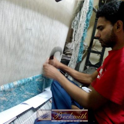 Man Making or Repairing a Carpet on a Loom