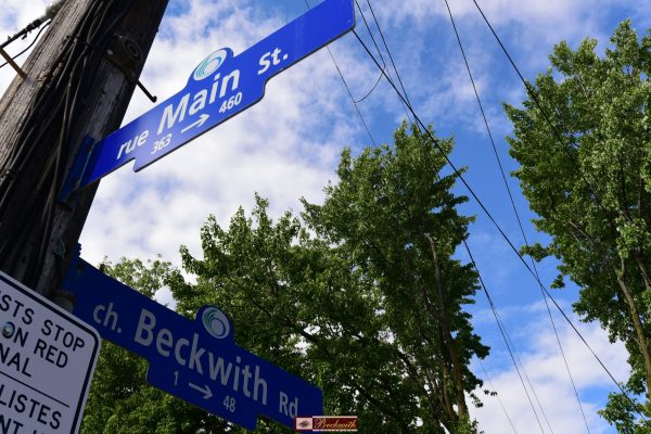 Main & Beckwith Street Signs outside of Beckwith Galleries