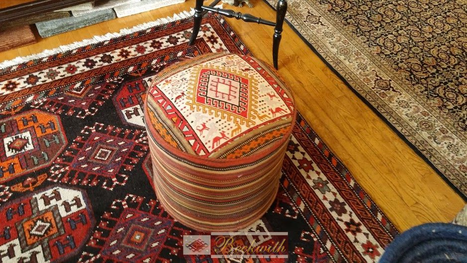 Photo of a stool and the corners of two carpets
