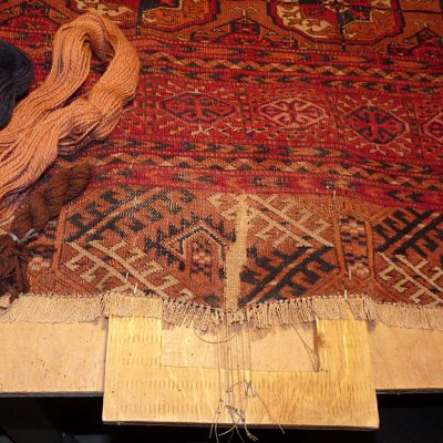 A rug during reweaving process