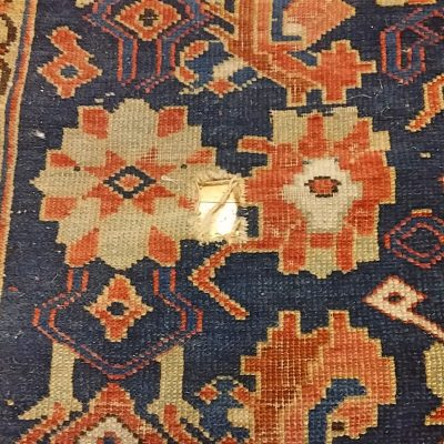 Hole in a Caucasian Oriental Rug - Before